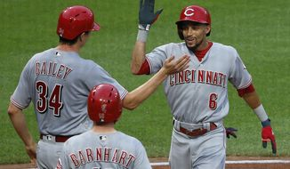 Cincinnati Reds' Billy Hamilton (6) celebrates with teammates Homer Bailey (34) and Tucker Barnhart (16) after hitting a three-run home run off Pittsburgh Pirates starting pitcher Jameson Taillon duruing the second inning of a baseball game in Pittsburgh, Tuesday, Aug. 1, 2017. (AP Photo/Gene J. Puskar)