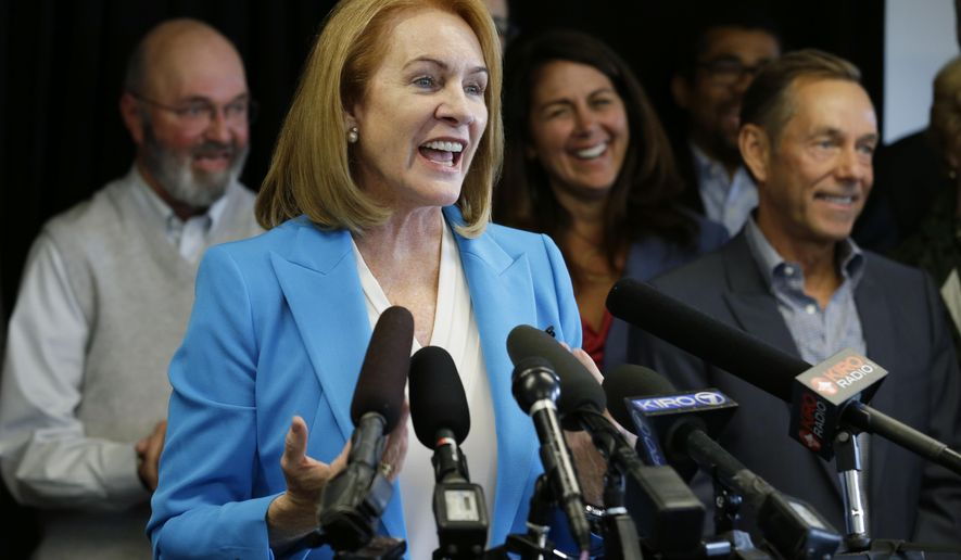 FILE - In this May 12, 2017, file photo, Jenny Durkan, a former U.S. Attorney, announces her candidacy for Seattle Mayor in Seattle. The top two candidates from a crowded field will emerge from the primary election, Tuesday, Aug. 1, 2017. (AP Photo/Ted S. Warren, File)