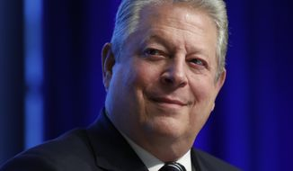 "In this April 21, 2017, file photo, former Vice President Al Gore participates in the ""Unlocking Financing For Climate Action"" session during the G20 at the 2017 World Bank Group Spring Meetings in Washington. Tangier Island mayor James ""Ooker"" Eskridge, an enthusiastic Trump supporter who is mayor of a Virginia island that's sinking into the Chesapeake Bay, will debate Gore on climate change during a CNN town hall that airs Tuesday, Aug. 1, at 9 p.m. (AP Photo/Carolyn Kaster, File)"