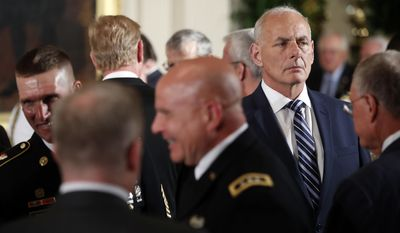 White House Chief of Staff John Kelly, rights, arrives at a event where President Donald Trump was bestowing the Medal of Honor to retired Army medic James McCloughan during a ceremony in the East Room of the White House in Washington, Monday, July 31, 2017.(AP Photo/Pablo Martinez Monsivais)