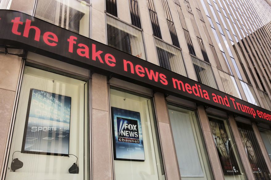 News headlines scroll above the Fox News studios in the News Corporation headquarters building in New York, Tuesday, Aug. 1, 2017. (AP Photo/Richard Drew)