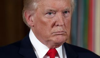 President Donald Trump looks across the room before he bestows the nation's highest military honor, the Medal of Honor to retired Army medic James McCloughan during a ceremony in the East Room of the White House in Washington, Monday, July 31, 2017. (AP Photo/Pablo Martinez Monsivais)