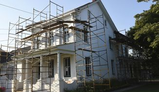 This July 31, 2017 photo shows the John Updike home in Shillington, Pa., that is currently undergoing renovations with scaffolding surrounding the house. The childhood home of the author is nearing its transformation into a museum and literary center. (Harold Hoch/Reading Eagle via AP)