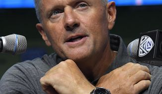 FILE - In this July 27, 2017, file photo, Utah head coach Kyle Whittingham speaks at Pac-12 NCAA college football Media Day, in the Hollywood section of Los Angeles. Utah is growing into a defensive back factory as the Utes are regularly sending cornerbacks and safeties to the NFL, including four off the 2016 roster. Coach Kyle Whittingham thinks the 2017 defensive backfield could be even better. (AP Photo/Mark J. Terrill, File)