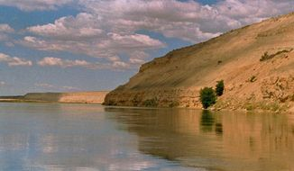 In this June 19, 2000, photo, bluffs along the Columbia River are among the scenic attractions of the Hanford Reach National Monument, Wash. Interior Secretary Ryan Zinke said Thursday, July 13, 2017 that Hanford Reach is no longer under review for possible modification of their protected status. (AP Photo/David Foster, File)