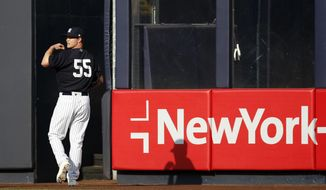 New York Yankees starting pitcher Sonny Gray looks over his shoulder after throwing in the outfield at Yankee Stadium in New York, Tuesday, Aug. 1, 2017, following his trade from the Oakland Athletics. (AP Photo/Kathy Willens)