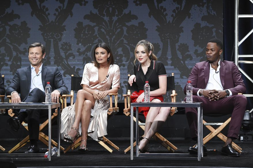 """Grant Show, from left, Nathalie Kelley, Elizabeth Gillies and Sam Adegoke participate in the """"Dynasty"""" panel during The CW portion of the 2017 Summer TCA's at the Beverly Hilton Hotel on Wednesday, Aug. 2, 2017, in Beverly Hills, Calif. (Photo by Richard Shotwell/Invision/AP)"""