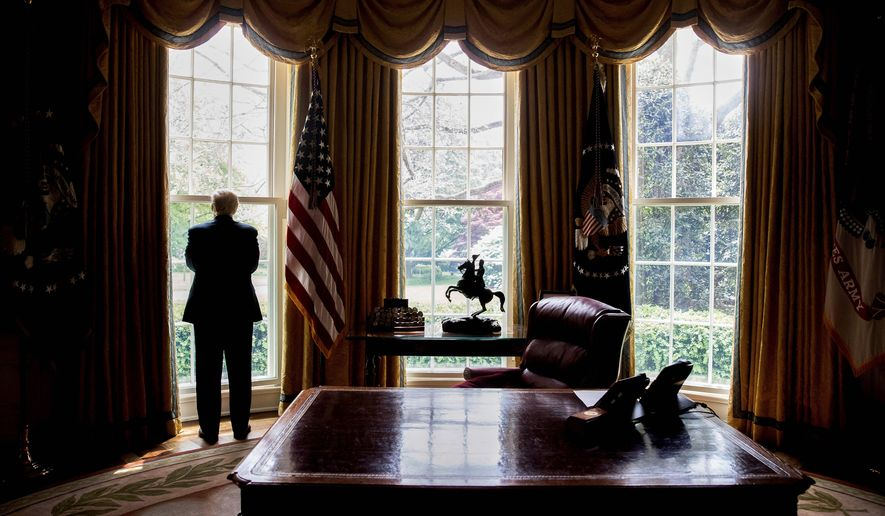 In this photo taken April 21, 2017, file photo, President Donald Trump looks out an Oval Office window at the White House in Washington following an interview with The Associated Press. (AP Photo/Andrew Harnik)' ** FILE **