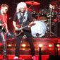 Adam Lambert, guitarist Brian May and drummer Roger Taylor celebrate the music of Queen at the Verizon Center. (Photograph by Joseph Szadkowski / The Washington Times)