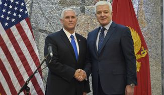 U.S. Vice President Mike Pence, left, shake hands with Montenegro's Prime Minister Dusko Markovic during a joint press conference in Villa Gorica in Podgorica, Montenegro on Wednesday, Aug. 2, 2017. Pence is attending the Adriatic Charter Summit in NATO's newest member - Montenegro, on Wednesday. (AP Photo/Risto Bozovic)