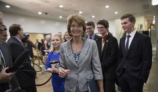 Sen. Lisa Murkowski, R-Alaska returns to her office on Capitol Hill in Washington, Wednesday, Aug. 2, 2017, as work in the Senate begins to wind down toward August recess. (AP Photo/J. Scott Applewhite) ** FILE **