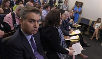 Jim Acosta of CNN listens during the daily briefing at the White House in Washington, Wednesday, Aug. 2, 2017. (AP Photo/Susan Walsh)