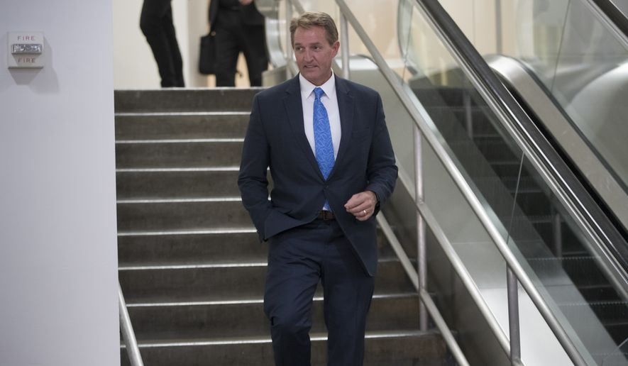 Senate Foreign Relations Committee member Sen. Jeff Flake, R-Ariz., and other members of the committee arrive on Capitol Hill Washington, Wednesday, Aug. 2, 2017, for a closed-door meeting with Secretary of State Rex Tillerson and Defense Secretary James Mattis. Earlier, President Donald Trump signed a bill to impose new sanctions on Russia which passed Congress with overwhelming support. (AP Photo/J. Scott Applewhite)
