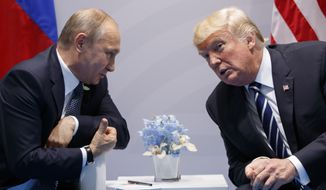 """In this July 7, 2017, file photo, President Donald Trump meets with Russian President Vladimir Putin at the G-20 Summit in Hamburg. Trump signed on Aug. 2, what he called a """"seriously flawed"""" bill imposing new sanctions on Russia, pressured by his Republican Party not to move on his own toward a warmer relationship with Moscow in light of Russian actions. (AP Photo/Evan Vucci, File)"""