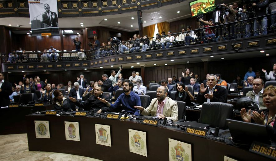 "Opposition lawmakers shout ""Fraud, fraud during a session of Venezuelan National Assembly in Caracas, Venezuela, Wednesday, Aug. 2, 2017. The CEO of the voting technology company Smartmatic said Wednesday that results of Venezuela's election for an all-powerful constituent assembly were off by at least 1 million votes. (AP Photo/Ariana Cubillos)"