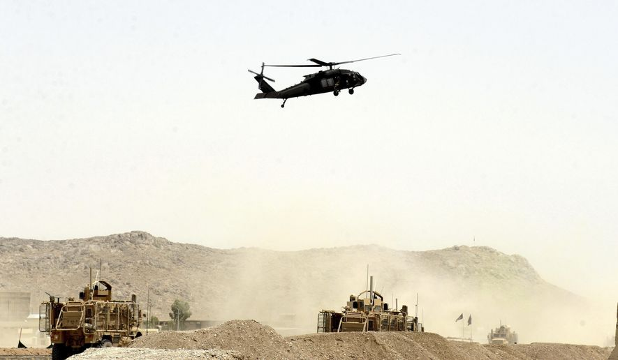 A U.S. military helicopter flew over the site of a suicide bomb that struck a NATO convoy in Kandahar, south of Kabul, Afghanistan, on Wednesday. Two Americans were reported killed (Associated Press)