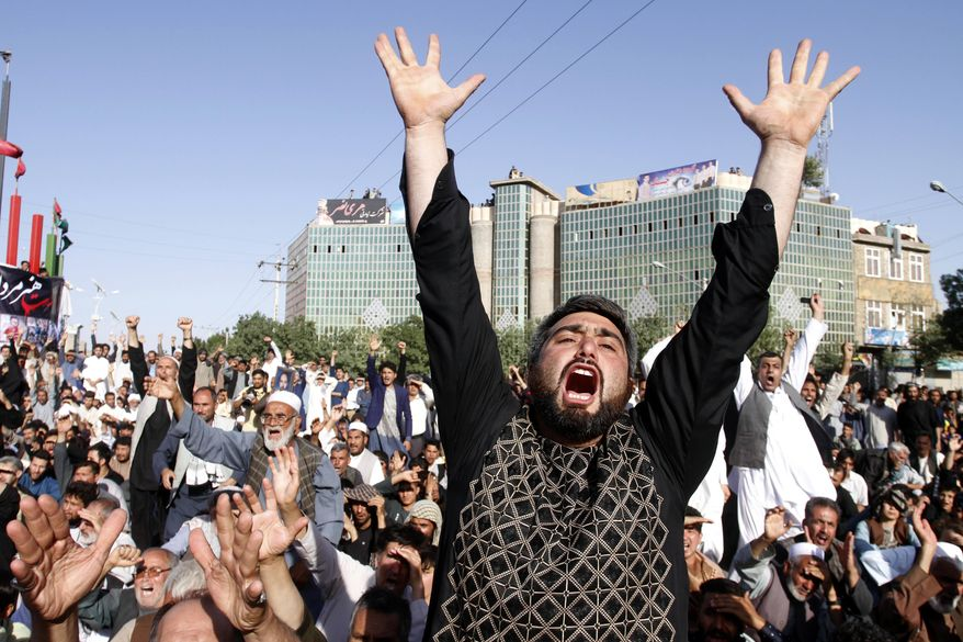 Protesters shout slogans during a demonstration in western Herat province of Afghanistan, Wednesday, Aug. 2, 2017. Thousands of angry residents carried the bodies of 31 people who died in a horrific suicide attack on a Shiite Mosque in western Herat. (AP Photo/Hamed Sarfarazi)