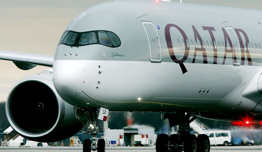 FILE- In this Jan. 15, 2015, file photo, a Qatar Airways jet arriving from Doha, Qatar, approaches the gate at the airport in Frankfurt, Germany. On Wednesday, Aug. 2, 2017, Qatar Airways said it is dropping an attempt to buy a big stake in American Airlines, an audacious bid that had received a chilly reception from American. (AP Photo/Michael Probst, File)