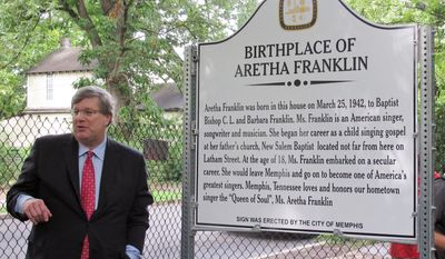 Memphis Mayor Jim Strickland stands next to a plaque marking the childhood home of soul singer Aretha Franklin on Wednesday, Aug. 2, 2017 in Memphis, Tenn. (AP Photo/Adrian Sainz)