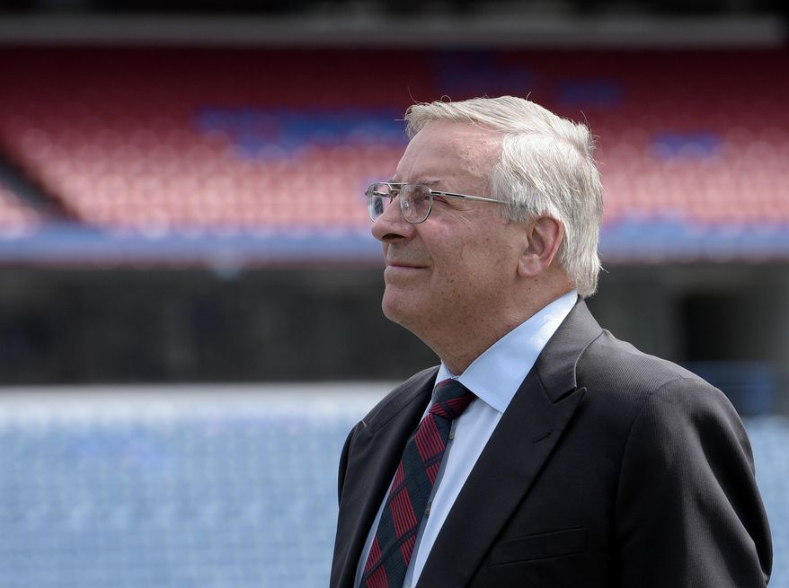 FILE - In this Aug. 18, 2016, file photo, Terry Pegula, Buffalo Bills owner and CEO, watches a video documenting the history of the team during a press conference in Orchard Park, N.Y. Pegula outlines one simple objective he would like to see his team achieve this year: Respect. He says the rest will eventually follow for a once-proud franchise whose reputation has been tarnished during a 17-year playoff drought. (AP Photo/Gary Wiepert, File)
