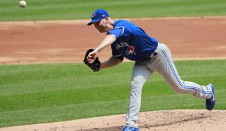Toronto Blue Jays starting pitcher J.A. Happ delivers during the first inning of a baseball game against the Chicago White Sox in Chicago, Wednesday, Aug. 2, 2017. (AP Photo/Jeff Haynes)