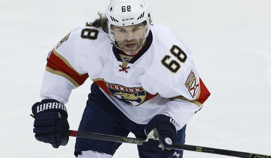 FILE - In this March 19, 2017, file photo, Florida Panthers' Jaromir Jagr skates in an NHL hockey game against the Pittsburgh Penguins in Pittsburgh. Jagr, 45, is looking for a team after finishing up his 24th pro season with the Florida Panthers, when he played every game and scored 16 goals with 30 assists. The previous year, he was awarded the Masterton Trophy for perseverance and sportsmanship while also receiving votes for the MVP and All-Star Game. (AP Photo/Gene J. Puskar, File)
