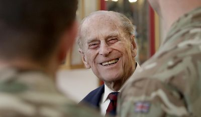 In this Thursday, March 30, 2017, file photo Britain's Prince Philip, in his capacity of Colonel, Grenadier Guards, chats to Sergeants from 1st Battalion Grenadier Guards in their Mess at Lille Barracks in Aldershot, England. Britain's Prince Philip on Wednesday Aug. 2, 2017 retires from solo official duties. Over the decades he has become renowned for his stalwart support of his wife, Queen Elizabeth II. (AP Photo/Matt Dunham, File)