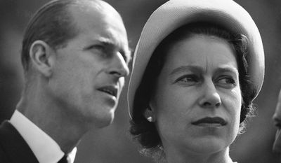 FILE - In this June 20, 1959 file photo Queen Elizabeth II and Prince Philip are pictured in Schefferville, as they listen to explanation on workings of an iron ore mine on another stop in their royal tour of Canada. Britain's Prince Philip on Wednesday Aug. 2, 2017 retires from solo official duties. Over the decades he has become renowned for his stalwart support of his wife, Queen Elizabeth II.  (AP Photo, File)