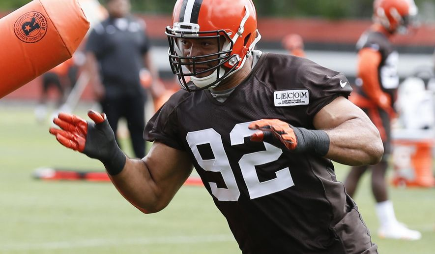 FILE - In this June 6, 2017, file photo, Cleveland Browns defensive end Desmond Bryant (92) runs a drill at the NFL football training facility, in Berea, Ohio. Bryant couldn't do anything to help the Browns last season after suffering a serious injury. Now that he's back on the field, the defensive end is relishing every moment because he knows how quickly it can all be taken away. (AP Photo/Ron Schwane, File)