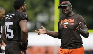 NFL Hall of Famer Bruce Smith, right, talks with Myles Garrett during practice at the NFL football team's training camp facility, Wednesday, Aug. 2, 2017, in Berea, Ohio. (AP Photo/Tony Dejak)