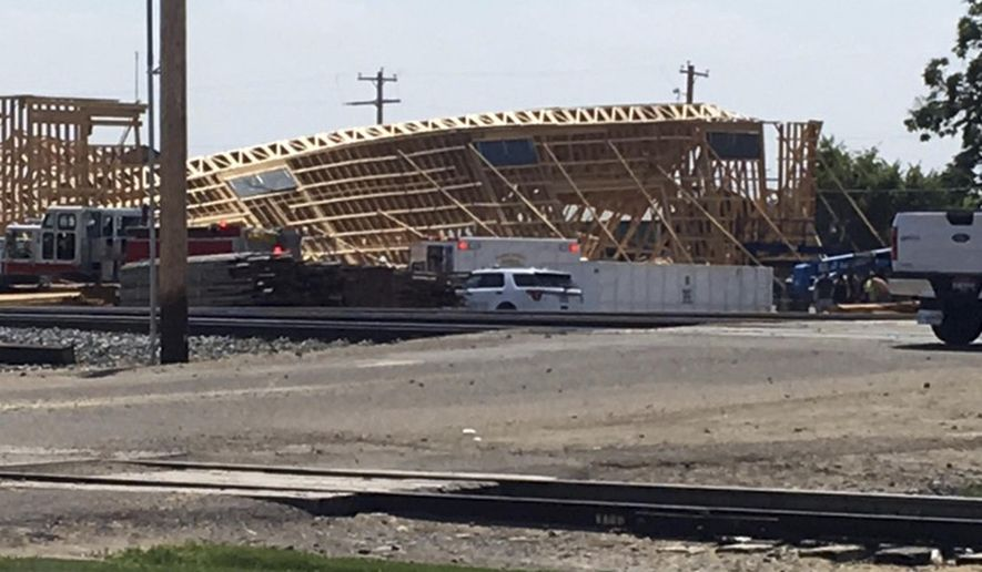 In this photo provided by Ashley Martin shows a building under construction in Parma, Idaho that collapsed Wednesday, Aug. 2, 2017, injuring several construction workers. The building is on land owned by the JC Watson Company, an onion packing operation. (Ashley Martin via AP)