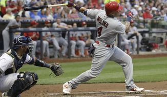 St. Louis Cardinals' Yadier Molina hits a home run during the fourth inning of a baseball game against the Milwaukee Brewers Wednesday, Aug. 2, 2017, in Milwaukee. (AP Photo/Morry Gash)