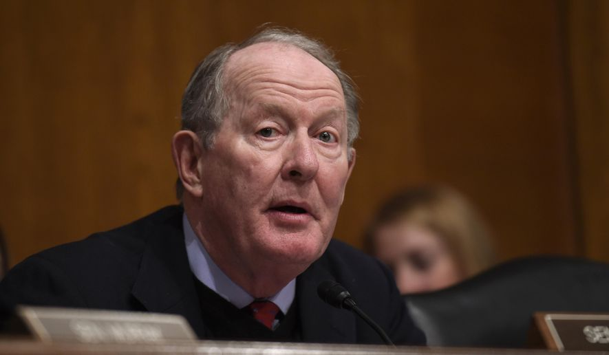 "Sen. Lamar Alexander, Tennessee Republican, said the administration's tariffs are ""like shooting ourselves in both feet"" because they raise prices for consumers while reducing revenue, profits, wages and jobs. (Associated Press/File)"