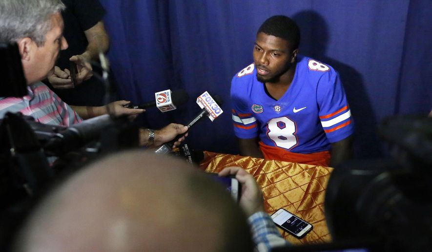 CORRECTS SPELLING TO ZAIRE, INSTEAD OF ZAIR - Florida quarterback Malik Zaire talks with the press during media day at Ben Hill Griffin Stadium in Gainesville, Fla. Wednesday, Aug. 2, 2017. [Brad McClenny/The Gainesville Sun via AP)