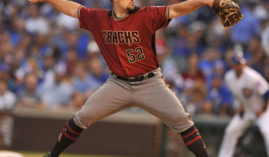 Arizona Diamondbacks starter Zack Godley delivers a pitch during the first inning of a baseball game against the Chicago Cubs Wednesday, Aug. 2, 2017, in Chicago. (AP Photo/Paul Beaty)