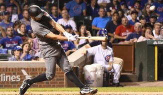 Arizona Diamondbacks' Adam Rosales hits an RBI-double during the fifth inning of a baseball game against the Chicago Cubs on Tuesday, Aug. 1, 2017, in Chicago. Reliever David Hernandez and infielder Rosales joined the Diamondbacks after they were acquired in a pair of trades. It's a reunion for Hernandez, who played for the Diamondbacks for four seasons before he signed with Philadelphia as a free agent in December 2015. (AP Photo/Matt Marton)