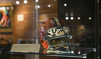In this Tuesday, Aug. 1, 2017 photo, the helmet of former Cleveland Browns football player Lou Groza sits in a display at the Canton Museum of Art in Canton, Ohio. A one-of-a-kind art exhibition devoted to football is making its last stop in Canton, the birthplace of the NFL. The exhibit opened Tuesday, days ahead of the Canton-based Pro Football Hall of Fame's enshrinement weekend. (AP Photo/Dake Kang