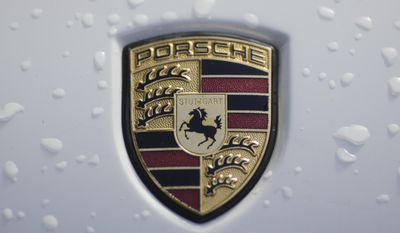 The brand logo of German car maker Porsche is photographed on a car in Berlin, Tuesday, Aug. 1, 2017. German Transport Minister Alexander Dobrindt and Environment Minister Barbara Hendricks call the heads of German car makers for a meeting named National Diesel Forum to Berlin on Wednesday, Aug. 3, 2017. (AP Photo/Markus Schreiber)