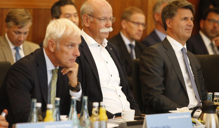 From right to left :  Harald Krueger, CEO of German car maker BMW, Dieter Zetsche, chairman of German car maker Daimler AG and head of Mercedes-Benz cars and Matthias Mueller, CEO of German car maker Volkswagen have taken seat to attend a so-called diesel summit on Wednesday, Aug. 2, 2017 in Berlin. German government officials and automakers meet to discuss the future of diesel vehicles, after a nearly two-year saga of scandal spread from Volkswagen to others in the sector. (Axel Schmidt/Pool Photo via AP)