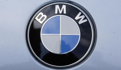 The brand logo of German car maker BMW is photographed on a car in Berlin, Tuesday, Aug. 1, 2017. German Transport Minister Alexander Dobrindt and Environment Minister Barbara Hendricks call the heads of German car makers for a meeting named National Diesel Forum to Berlin on Wednesday, Aug. 3, 2017. (AP Photo/Markus Schreiber)