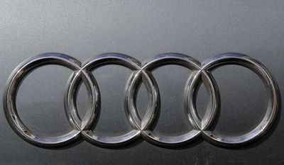 The brand logo of German car maker Audi is photographed on a car in Berlin, Tuesday, Aug. 1, 2017. German Transport Minister Alexander Dobrindt and Environment Minister Barbara Hendricks call the heads of German car makers for a meeting named National Diesel Forum to Berlin on Wednesday, Aug. 3, 2017. (AP Photo/Markus Schreiber)