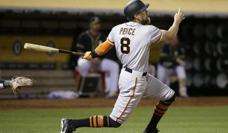 San Francisco Giants' Hunter Pence hits a three-run home run off Oakland Athletics relief pitcher Michael Brady in the sixth inning of a baseball game Tuesday, Aug. 1, 2017, in Oakland, Calif. (AP Photo/Eric Risberg)