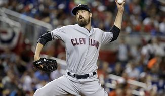 FILE - In this Tuesday, July 11, 2017 file photo, American League's Cleveland Indians pitcher Andrew Miller throws a pitch, during the MLB baseball All-Star Game in Miami. The Cleveland Indians have placed All-Star reliever Andrew Miller on the disabled list with right knee tendinitis. Miller is one of baseball's best late-innings pitchers and he's one of the most important players for the defending AL champions. He has been uncharacteristically wild of late, walking 10 batters in the past 21 innings. (AP Photo/Lynne Sladky, File)