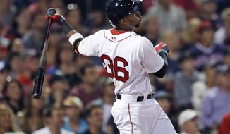 Boston Red Sox's Eduardo Nunez watches the flight of his three-run double off Cleveland Indians relief pitcher Andrew Miller during the sixth inning of a baseball game at Fenway Park, Tuesday, Aug. 1, 2017, in Boston. (AP Photo/Charles Krupa)