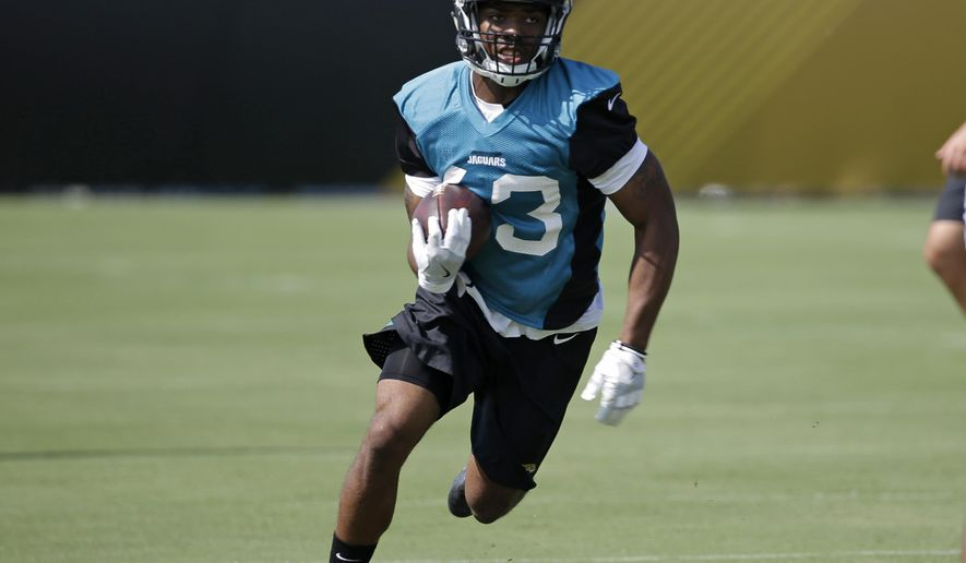 "FILE - In this July 28, 2017, file photo, Jacksonville Jaguars running back I'Tavius Mathers (43) runs through a drill during NFL football training camp, in Jacksonville, Fla. Mathers will be released from the hospital a day after suffering a neck injury during practice. The team says Mathers will return to the football facility Wednesday, Aug. 2, 2017, and the medical staff will work with him to ""decide the best course of action for his recovery.""(AP Photo/John Raoux, File)"