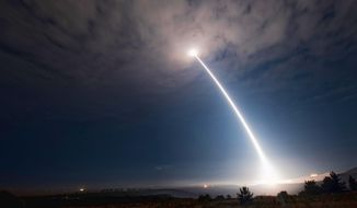 In this image taken with a slow shutter speed and provided by Vandenberg Air Force Base, an unarmed Minuteman 3 missile launches from Vandenberg Air Force Base, Calif.,  Wednesday, Aug. 2, 2107. The U.S. Air Force has successfully launched the unarmed intercontinental ballistic missile, the fourth such test this year. (Senior Airman Ian Dudley/Vandenberg Air Force Base via AP)