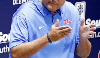 Mississippi interim coach Matt Luke discusses his expectations for the NCAA college football team's season, Wednesday, Aug. 2, 2017, in Oxford, Miss. Mississippi opens its preseason camp after a tumultuous offseason highlighted by the stunning resignation of coach Hugh Freeze last month. (AP Photo/Rogelio V. Solis)