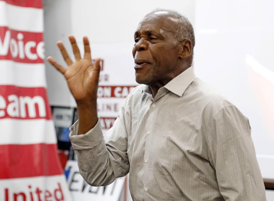 In this Tuesday, Aug. 1, 2017, photo, actor and human rights activist Danny Glover addresses UAW members and Nissan employees at the UAW Canton, Miss., headquarters during a work rally, near the Nissan vehicle assembly plant. Glover participated in the small rally to maintain workers' morale, while UAW workers set up an informational line outside employee entrances at the Nissan plant. The UAW has a vote scheduled Aug. 3-4, on whether it should represent the 3,700 full-time company workers. (AP Photo/Rogelio V. Solis)