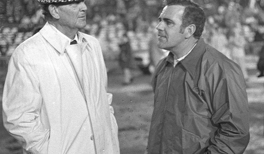 "FILE - In this Dec. 31, 1973, file photo, Alabama coach Paul ""Bear"" Bryant, left, talks with Notre Dame coach Ara Parseghian prior to the Sugar Bowl college football game, in New Orleans, La. Parseghian, who took over a foundering Notre Dame football program and restored it to glory with two national championships in 11 seasons, died Wednesday, Aug. 2, 2017, at his home in Granger, Ind. He was 94. (AP Photo/Joe Raymond/File)"