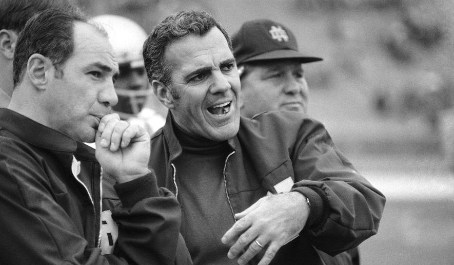 FILE - In this Oct. 31, 1970, file photo, Navy head coach Rick Forzano, left, and Notre Dame head coach Ara Parseghian talk on the sideline during a football game in Philadelphia. Notre Dame defeated Navy 56-7. Parseghian died Wednesday, Aug. 2, 2017, at his home in Granger, Ind. he was 94. (AP Photo/File)